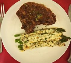 Pan Fried Parmesan Pork Chops with Cheesy Baked Asparagus is WAY easier than it sounds. This is an easy weeknight supper that tastes like a Sunday sit down dinner. Let's do it!