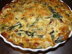 Number of Servings: 6  Ingredients  1 medium onion, diced  6 ounces Fresh Express Baby Spinach  2 large eggs  1/2 cup egg beaters (liquid substitute)  1/2 cup all purpose flour  1/2 tsp baking powder  pinch cayenne pepper  1 1/3 cups non fat milk  1/2 cup feta
