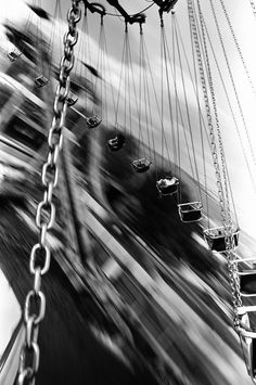 MOTION BLUR - Love the swing pictures. Most people would stay on the ground and take the picture but this one the photographer is obviously on the swings. Photo Black, Black N White, Black And White Pictures, Motion Photography, Art Photography, Panning Photography, Great Photos, Black And White Photography, Photo Art