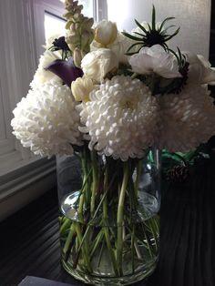 White China Mums | tulips | anemones | tuberose | black and white centerpiece