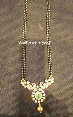 Black Beads Chain with Peacock Pendant photo
