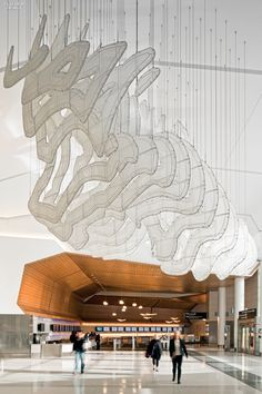 The sculptured ceiling funnels in natural light through clerestories and skylights. Photography by Joe Fletcher.