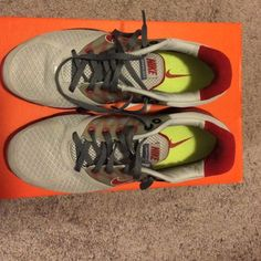 Nike Lunarglide 2 Gray and red Nike Lunarglide 2. Women's size 8.5. Worn a few times. In great condition. Good for working out or just casual every day wearing. Nike Shoes Sneakers
