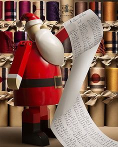 Mr Claus is making a list and he's checking it twice... @Burberry scarves are being wrapped for the holidays.