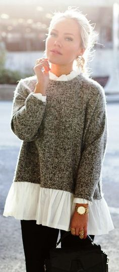 Knit sweater with lace accents at the waist, cuff, and neckline.