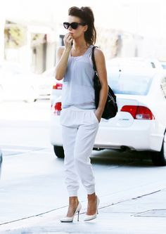 Kate Beckinsale in white athletic pants, silk tank top, white pumps, and black cat-eye sunglasses