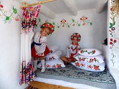 Ukrainian girls inside their embroidered cubby.