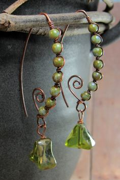 Uniquely different, these Earthy green Czech glass beads remind me of sweet peas! I strung them on the leaf shaped frame of the ear wire and