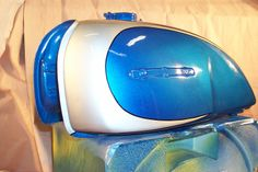 Honda tank. Nice pearl blue from the Dodge color pallet.  One Shot silver on the front.