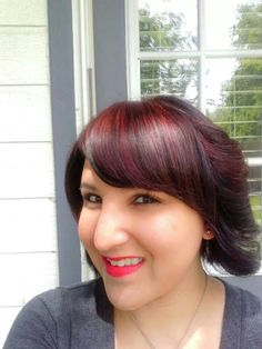 Hair color done by a good friend of mine... using Paul Mitchell (The Color) 4 Red Violet as the base color and 6rv dark blonde red for my highlights  This is by far the best color my friend and I have come up with :)