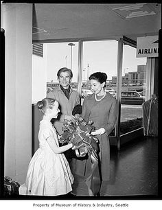 Ballet stars Margot Fonteyn and Rudolph Nureyev being handed a bouquet by Francesca Corkle at Sea-Tac airport, Sea-Tac, 1963