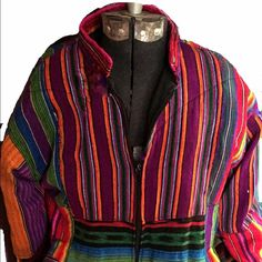 Handmade loomed Equadorian jacket price firm. Super bold colors to accent you, as as spring finally approaches. 🌺 Size medium on tag, but runs more to a size 6. Supreme needlework allows you to wear it on the black side if you wish(zipper won't work on that side though). May have some imperfections due to type of fabric and age(vintage late 70's). Jackets & Coats