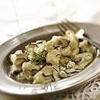 Gnocchi with Blue Cheese, Wild Mushrooms and Rosemary Madeira Cream - This outstanding recipe for potato gnocchi served with a rich cream sauce made with wild mushrooms, fresh rosemary, Madeira and blue cheese was created by Chef Louis Moskow.