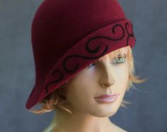 This beautiful ladies cloche is made from fur felt, and hand draped over an antique hat block. Hand finished with authentic millinery techniques. Please indicate your head size measurement when ordering (measure your head horizontally just above your eyebrows). When you receive your hat, there will be a small ribbon inside to fine-tune the fit, and a hat box for safe storage.  Note: Colors will vary depending on your monitor and there will also be some variations due to dye lots. I…