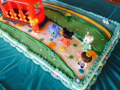 Daniel the Tiger Sheet Cake! Rainbow and dots made with mm fondant.