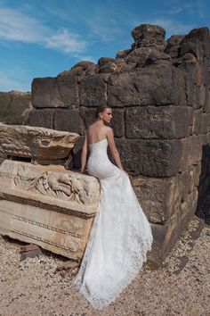 377733521ea Wedding Dresses Inspiration   Beautiful lace train on this Lian Rokman  wedding dress