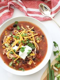 Slow Cooker Chicken Enchilada Soup #recipe on foodiecrush.com