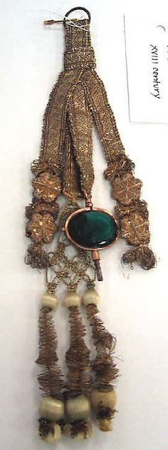 Fob Date: 18th century Culture: French Medium: silk, metal thread, glass Dimensions: Length: 9 in. (22.9 cm) Credit Line: Anonymous Gift, 1924 Accession Number: 24.166.20