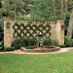 Garden wall with espalier and fountain Wall Climbing Plants, Climbing Vines, Amazing Gardens, Beautiful Gardens, Blank Wall Solutions, Landscape Design, Garden Design, Espalier, Ivy Wall