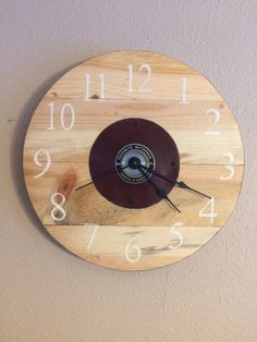 A personal favorite from my Etsy shop https://www.etsy.com/listing/244166835/12-tape-measure-pallet-clock-exact-one