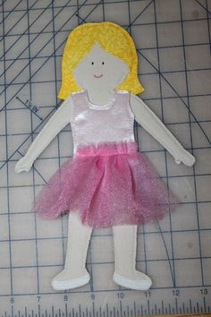 I made these for my 4-year-old daughter Joanna for Christmas. They were a big hit! They look more complicated than they are. You can make a doll and a nice little wardrobe in an afternoon. What you will need: For the doll: Skin-colored cotton fabric and matching thread, ultra firm fusible interfacing, Heat n' Bond (or similar) sewable iron-on adhesive, pencil or air-soluble marker, cotton fabric and matching thread for hair, sew-on hook and loop fastener (hook side only), and craft paint…