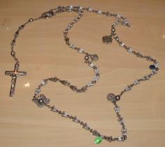 Solid Sterling Silver Creed Cross Rosary with Wedding Bell Beads. This stunning rosary & crucifix features 7 unique charms with religious figures of Virgin Mary, Jesus Christ, St Andrew, Joseph etc. It has a date of 1830 on one of the charms. Best offer is available. #Sterling #Religion #Jesus #God #Vintage #Antique #Silver