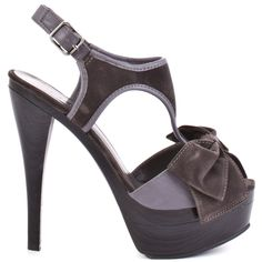 This shoe is perfect for drinks or dinner with the girls. Michael Antonio's Takara will be a favorite with its two contrasting shades of grey.  A 1 1/2 inch faux black wood platform and serious 5 1/2 inch heel adds a bold touch. A feminine grey bow at the vamp gives the finishing touch to this gorgeous silhouette.
