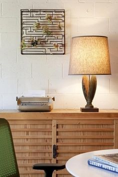 overall feeling of wood cabinet, lamp, wall hanger, wall color, color of green chair