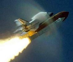Space Shuttle with all engines fired, breaking the sound barrier...Mach 1