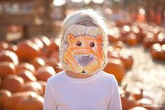 Young child with homemade lion mask © Wendell/Dambrosia