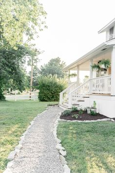 Lay a gravel path for an affordable landscaping solution. Farmhouse on Boone shares how to get exterior wow factor in a weekend.