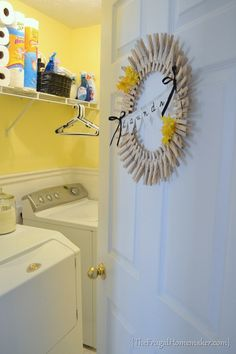 Laundry Room, yellow walls with orange flower?