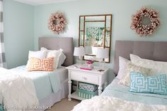 Sophisticated girls bedroom makeover for a teenager featuring light green walls and a white, blue and pink color scheme. Love the pops of color.