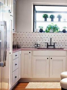 geometric tile white block tile backsplash and pink countertop
