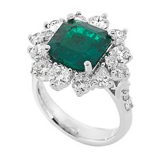 RE25144H: A 3.52ct emerald center stone surrounded by a wreath of the finest premium cut round diamonds (1.68ct set in platinum)