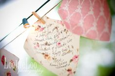 The guests write a note for the bride and groom on a piece of fabric, pin it above the dance floor for the wedding, and it will be sewn into a quilt later!