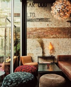 FAVORITE look.  Hands down.  Small living room like seating areas, eclectic, low dividers here and there.  Cool pictures on the wall of interesting people.