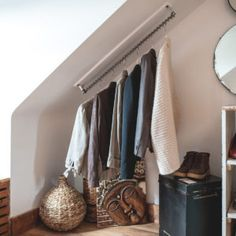 Zebedee Hanging Rail is the solution to the problem of angled / sloping ceilings! It will fit any angle, is off the shelf, and not just for clothes!