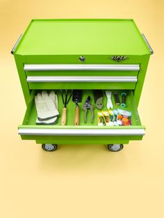 Love this idea of using a metal tool chest (especially in green) to a garden cart...just a bit on the expensive side