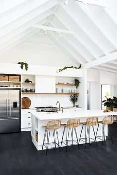 Another slice of farmhouse kitchen heaven! Classic white cabinets mixed with dark timber tones.