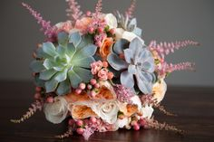 Stunning floral arrangement with succulent! #roses #succulent #floralarrangement #powerstationevents #inbloomfloral