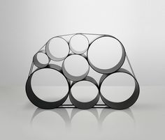 Courbes, rondeurs, ondulations ou cercles dessinent des formes sinueuses, convexes ou concaves pour des bibliothèques organiques ou futuristes.