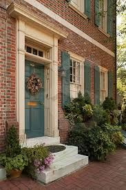 Brick exterior with pretty blue shutters.