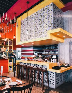 HGTV loves this Mexican taqueria restaurant with pink, red and yellow paint; yellow bar and rustic wood bar stools. Pink Restaurant, Mexican Restaurant Design, Mexican Interior Design, Mexican Bar, Taco Restaurant, Restaurant Interior Design, Home Interior, Interior Decorating, Mexican Style