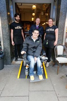 News from London: Matthew Kayne gets ready to enjoy his first coffee inside Caffè Nero with MP Mike Freer. Golders Green becoming disabled friendly.
