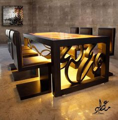 arabic calligraphy on table: