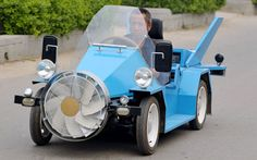 Crazy car.  A farmer from Beijing has created a 'wind-powered' vehicle that can reach speeds of 140km/h. The vehicle boasts batteries and electric generators, a fan in the front and two 'solar energy wings' on the back to support electricity generation.  Picture: Quirky China News / Rex Features
