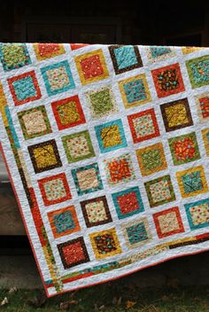 Scrappy quilt. Like the border a lot!!