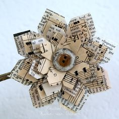 Idea: music sheets, old paper and button flower