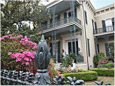 beautiful home in the Garden District of New Orleans with a cornstalk iron fence